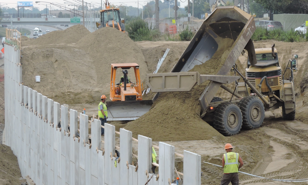 Trucks Carrying Backfill for MSE
