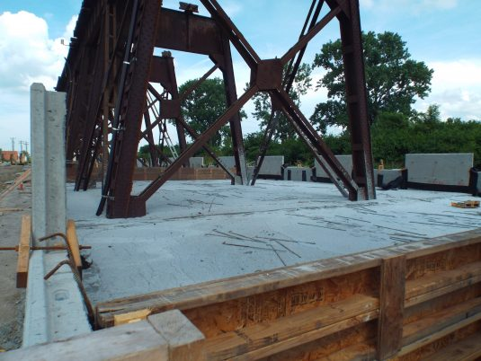 Construction of Base of Reinforced Earth® Wall at Merchants Bridge