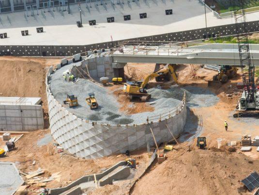 Soil Being Spread During Construction of Mercedes-Benz Stadium Northside Drive Pedestrian Bridge