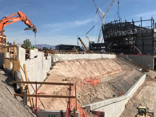Allegiant Stadium - Under construction in background with wall reinforcement being installed