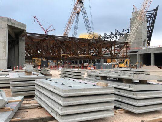 Allegiant Stadium - Under construction in background with wall reinforcement slabs in foreground